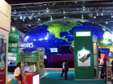 The giant globe of the Emirates Airline booth dominates the hall