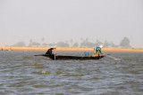 Men fishing from a pirogue on the Niger River near Mopti, Mali