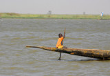 Young boy steering the pirogue, Niger River, Mali