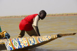 Boy in the bow of a 2006 pirogue, Niger River, Mali