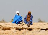 Fulani men sitting near the Niger River, Mali