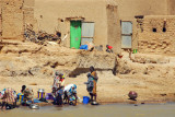 Girls washing dishes in the Niger River, Mali