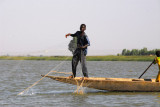 Boy fishing in the Niger River with nets, Kotaka
