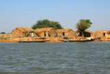 Niger River village with fishing boats, Mali