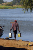 Man going to the river to fetch water