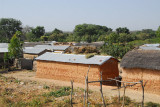 Long rectangular mud huts with tin roofs, Benin