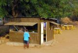 Roadside tin stall with American flag, Benin