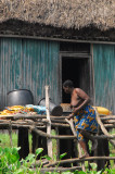 Woman climbing down from her hut