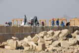 Workers restoring a section of the defensive wall of the Ancient City of Palmyra