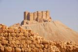 The Arab Citadel rising behind ruins of the defensive wall of Diocletian's Camp, Palmyra