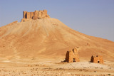 Volcanic cone with Palmyra Castle and a pair of ancient tombs
