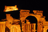 Monumental Archway and Arab Citadel, Palmyra, illuminated at night
