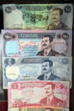 Iraqi banknotes with Saddam Hussein