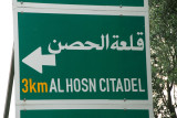 The Arabic name for Krak des Chevaliers is Qalat Al Hosn - most signs use tha tname