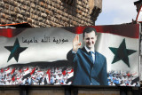 A giant billboard of Bashar greets visitors to the famous Hamidiya Souq in the Old City of Damascus
