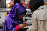 Fortuneteller working the sidewalk, Ginza