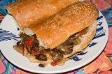 mushroom onion pepper cheesesteak sandwich