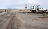 Repairing a STOP sign at the grade crossing at Knolls, Utah