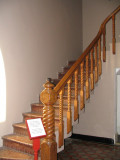 Back staircase turned newel post and baluster.jpg