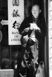 Man in doorway in Chinatown