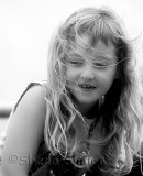 Little girl on ferry in black and white