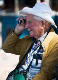 Elderly man with telescope