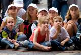 Kids watching busker