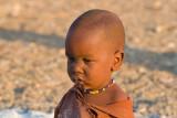 Reflective Himba child portrait.jpg
