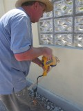 Bill spraying paint on the walls