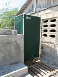 portable shower with rain water collected in the tank beside it
