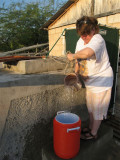Jean collecting water to wash with