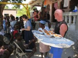 passing out bread, spaghetti sauce and fruit to the locals that hung out at our place every day