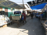 taking our supplies from the boat to the truck through the market