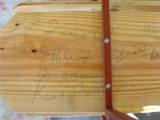 bottom of a church bench that we signed