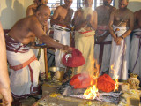 Srikaryam Swami submitting Poorna Ahuthi in Homam