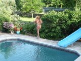 Summer of '07 is here and Belle is in rare form. Some great new swimsuits to show off. There is some nudity included
