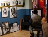 artist sketching in market