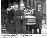 I DOUBT THAT THE EATON FUNERAL, IS AS SUGGESTED.  (SIR JOHN EATON'S FUNERAL.)  1) MID, TO LATE '30s.  2) CLOTH COVERED COFFIN.  3) SERVICE NOT AT THE TIMOTHY EATON CHURCH.  4) LADY EATON/JOHN JR NOT TO BE SEEN.  NOTE: OF THE TWO MEN FACING EACH OTHER, WILLIAM (BILL) MILES  IS ON THE LEFT (ALFRED ROGERS BEHIND HIM) AND MILES' OWN  COACH DRIVER IS ON THE RIGHT.