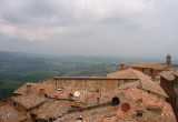 Rooftops and Montepulciano landscape from tower