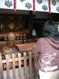 Praying at the smaller shrine