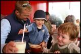 Boys eyeing the smoothie