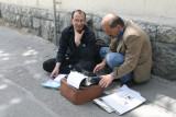 Letter writer and his client - Brievenschrijver met zijn cliënt.