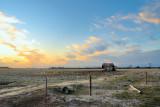 Dusk on a barren farm