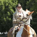 grinning cowboy on horse