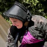woman in black bonnet.