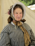 woman with checked bonnet