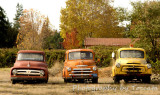 3 old pick up trucks