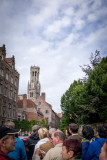 boat tour of Bruges: fellow at front, light brown tam