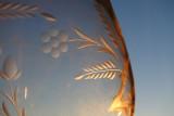 Sunrise through a cut glass goblet
