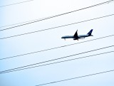 An Airplane Flying Through Lines